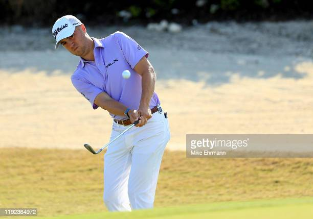 Justin Thomas of the United States chips on the 14th hole during the third round of the Hero World Challenge on December 06, 2019 in Nassau, Bahamas.