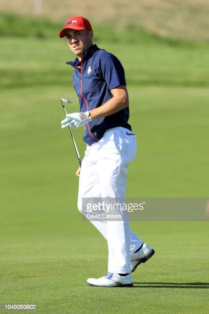 Justin Thomas of the United States follows his second shot on the 17th hole in his match against Rory McIlroy of the European Team during singles...