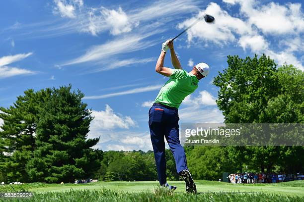 Justin Thomas of the United States hits a tee shot during a practice round prior to the 2016 PGA Championship at Baltusrol Golf Club on July 26, 2016...