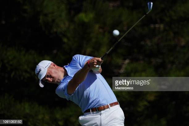 Justin Thomas of the United States hits a tee shot on the 2nd hole during the final round of the Sentry Tournament of Champions at the Plantation...