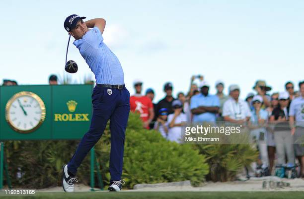 Justin Thomas of the United States hits is tee shot on the first hole during the final round of the Hero World Challenge at Albany on December 07,...