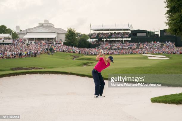 Justin Thomas of the United States hits out of the bunker on the 18th hole during the Final Round for the 99th PGA Championship held at Quail Hollow...