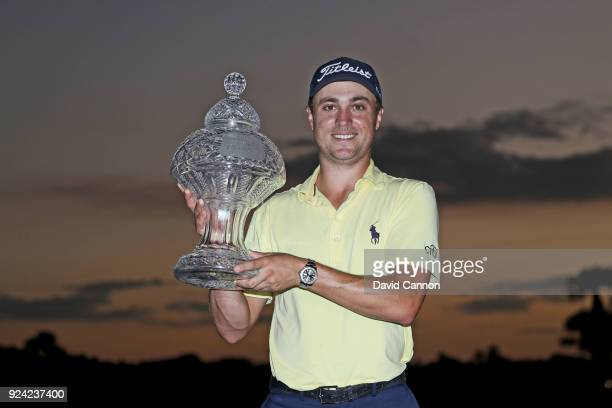 Justin Thomas of the United States holds teh trophy after his playoff win in the final round of the 2018 Honda Classic on The Champions Course at PGA...
