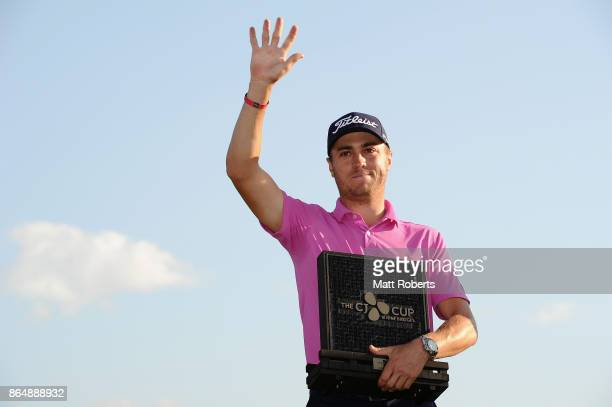 Justin Thomas of the United States holds the trophy after winning the CJ Cup at Nine Bridges on October 22 2017 in Jeju South Korea