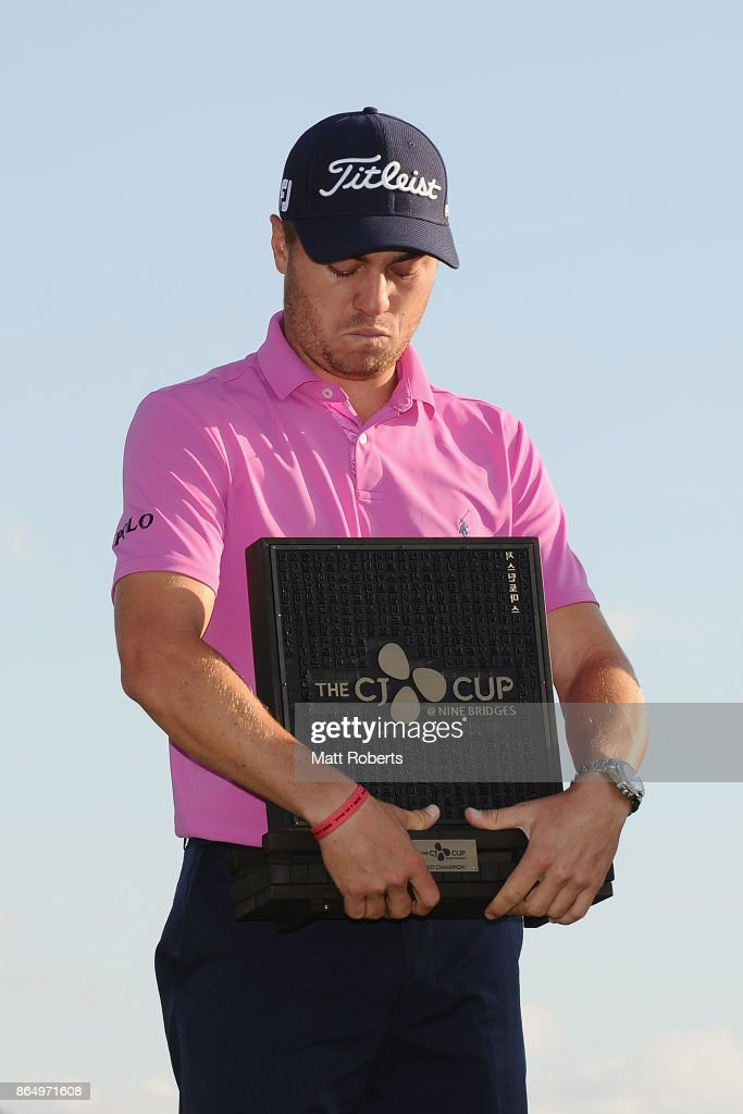 Justin Thomas of the United States holds the trophy after winning the CJ Cup at Nine Bridges on October 22, 2017 in Jeju, South Korea.