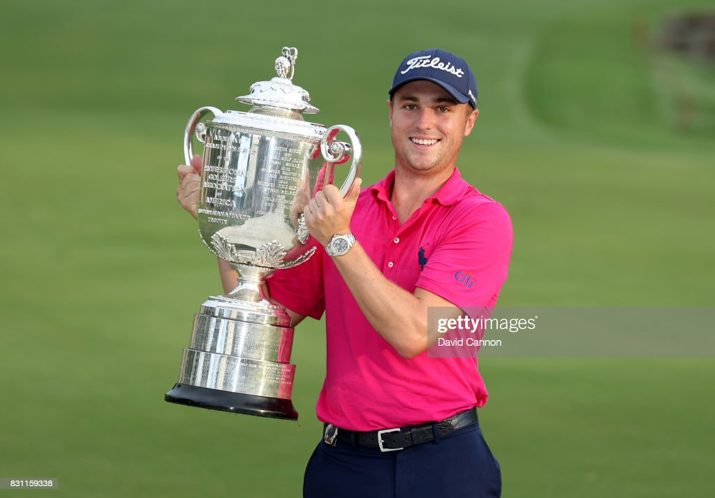 Justin Thomas of the United States holds the Wanamaker Trophy at the presentation after the final round of the 2017 PGA Championship at Quail Hollow on August 13, 2017 in Charlotte, North Carolina.