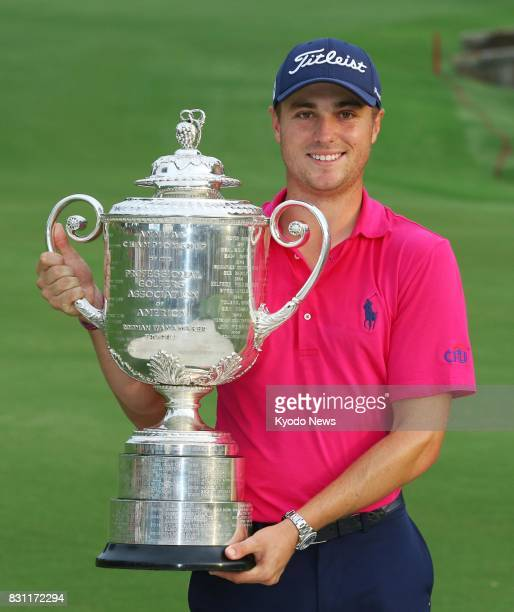 Justin Thomas of the United States holds the winner's trophy after a twoshot victory at the PGA Championship his first major title at Quail Hollow...
