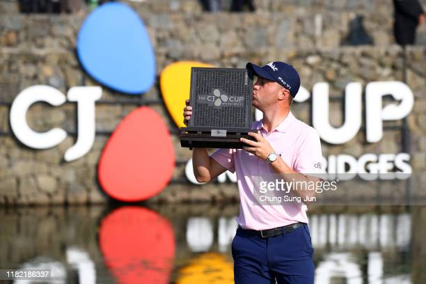Justin Thomas of the United States kisses the trophy after winning the tournament during the final round of the CJ Cup @Nine Bridges at the Club at...