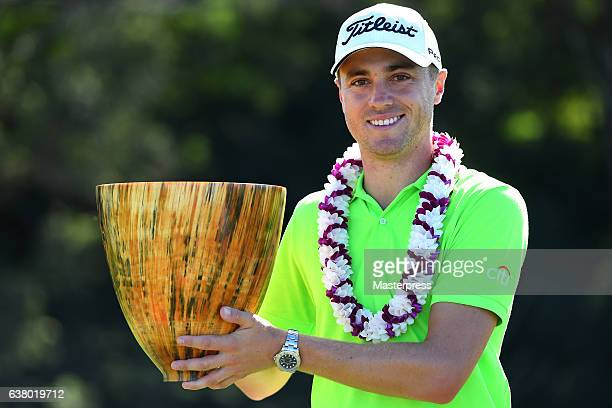 Justin Thomas of the United States lifts the trophy after the final round of the SBS Tournament of Champions at the Plantation Course at Kapalua Golf...