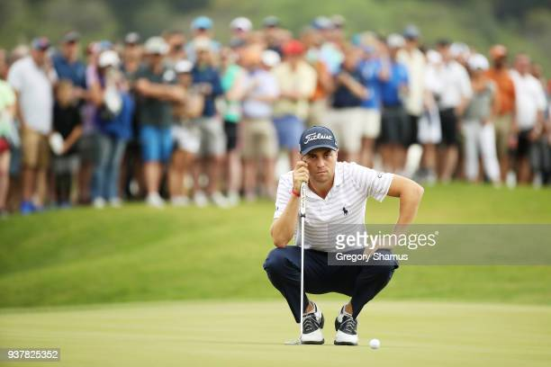 Justin Thomas of the United States lines up a putt on the 15th green during his semifinal round match against Bubba Watson of the United States in...