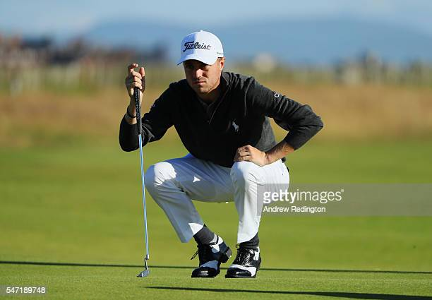 Justin Thomas of the United States lines up a putt on the 1st during the first round on day one of the 145th Open Championship at Royal Troon on July...
