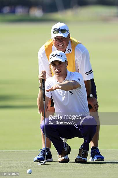 Justin Thomas of the United States lines up a putt on the ninth green during the second round of the Sony Open In Hawaii at Waialae Country Club on...