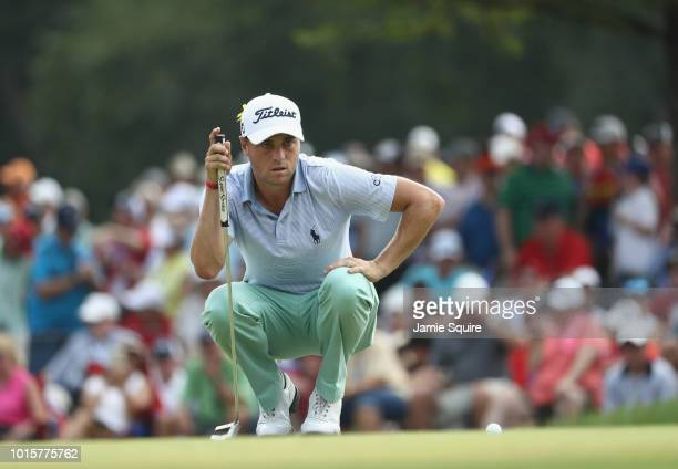 Justin Thomas of the United States lines up a putt on the tenth green during the final round of the 2018 PGA Championship at Bellerive Country Club...