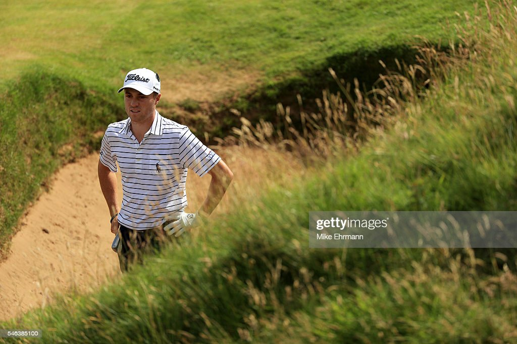 Justin Thomas of the United States looks on from a bunker on the on the 8th hole during a practice round ahead of the 145th Open Championship at Royal Troon on July 12, 2016 in Troon, Scotland.