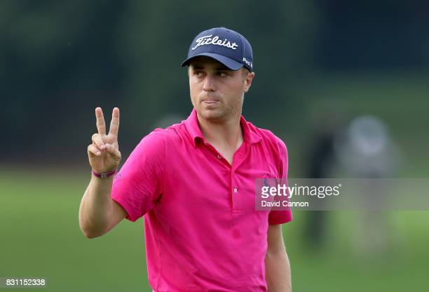 Justin Thomas of the United States makes a birdie two on the par 3 17th hole during the final round of the 2017 PGA Championship at Quail Hollow on...
