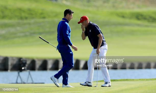 Justin Thomas of the United States misses a birdie putt on the 15th hole in his match against Rory McIlroy of the European Team during singles...
