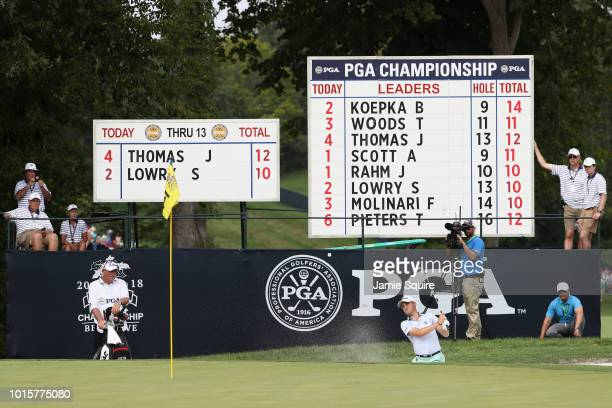 Justin Thomas of the United States plays a shot from a bunker on the 14th hole during the final round of the 2018 PGA Championship at Bellerive...
