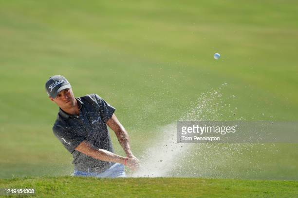 Justin Thomas of the United States plays a shot from a bunker on the 18th hole during the third round of the Charles Schwab Challenge on June 13 2020...
