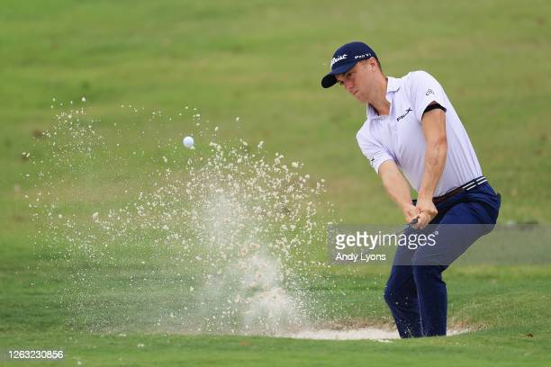 Justin Thomas of the United States plays a shot from a bunker on the 16th hole during the third round of the World Golf Championship-FedEx St Jude...