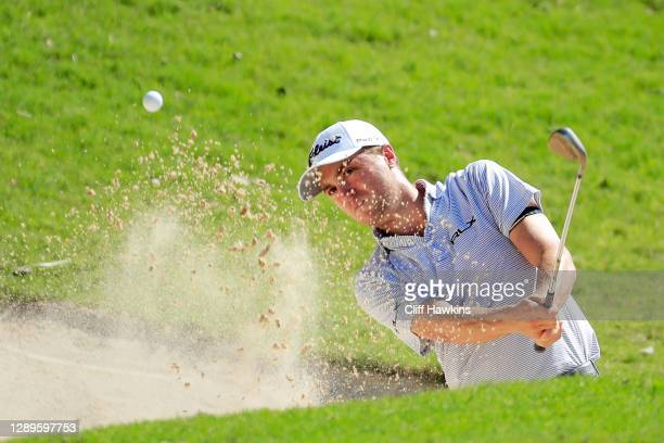 Justin Thomas of the United States plays a shot from a bunker on the 18th hole during the third round of the Mayakoba Golf Classic at El Camaleón...