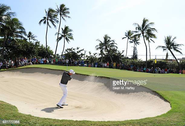 Justin Thomas of the United States plays a shot from a bunker on the sixth hole during the final round of the Sony Open In Hawaii at Waialae Country...