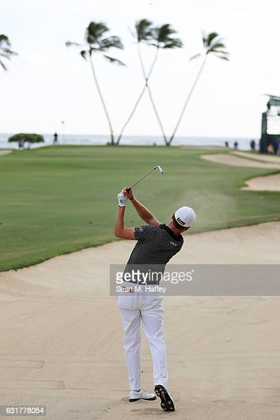 Justin Thomas of the United States plays a shot from a bunker on the 16th hole during the final round of the Sony Open In Hawaii at Waialae Country...