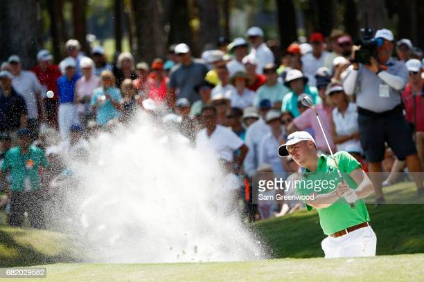Justin Thomas of the United States plays a shot from a bunker on the eighth hole during the first round of THE PLAYERS Championship at the Stadium...