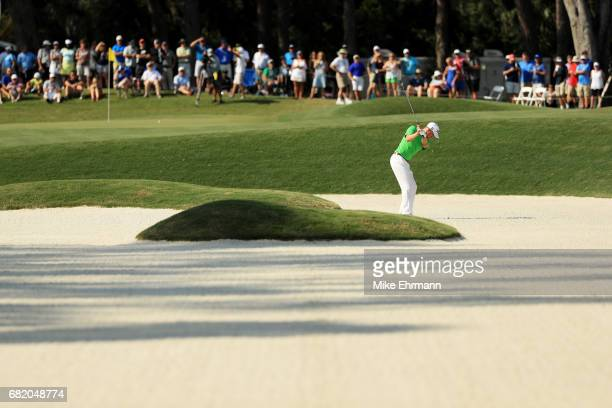 Justin Thomas of the United States plays a shot from a bunker on the 12th hole during the first round of THE PLAYERS Championship at the Stadium...