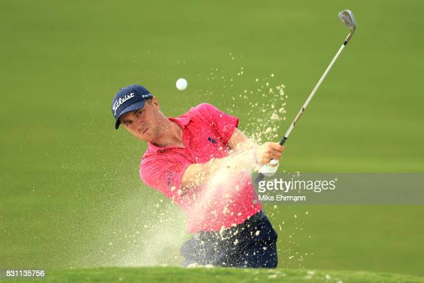 Justin Thomas of the United States plays a shot from a bunker on the 16th hole during the final round of the 2017 PGA Championship at Quail Hollow...