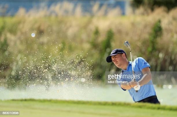 Justin Thomas of the United States plays a shot from a bunker on the fifth hole during the first round of the Hero World Challenge at Albany Bahamas...