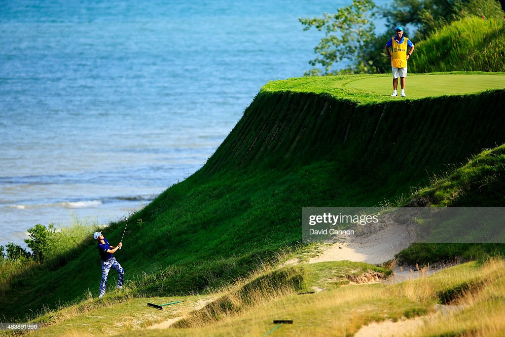 Justin Thomas of the United States plays a shot on the 17th hole during the first round of the 2015 PGA Championship at Whistling Straits on August 13, 2015 in Sheboygan, Wisconsin.