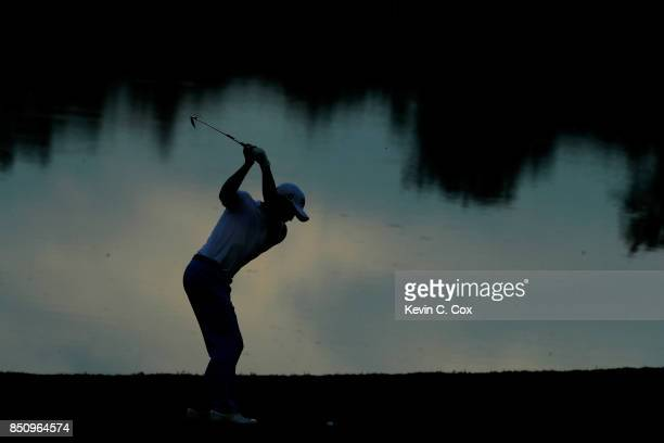 Justin Thomas of the United States plays a shot on the 18th hole during the first round of the TOUR Championship at East Lake Golf Club on September...