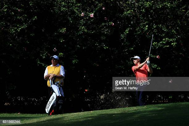 Justin Thomas of the United States plays a shot on the sixth hole during the first round of the Sony Open In Hawaii at Waialae Country Club on...