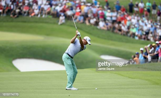 Justin Thomas of the United States plays a shot on the tenth hole during the final round of the 2018 PGA Championship at Bellerive Country Club on...