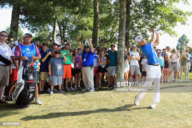 Justin Thomas of the United States plays a shot on the tenth hole during the final round of the Dell Technologies Championship at TPC Boston on...