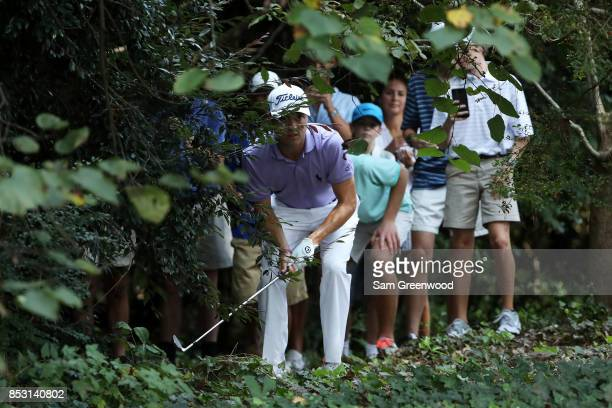Justin Thomas of the United States plays from the trees on the seventh hole during the final round of the TOUR Championship at East Lake Golf Club on...