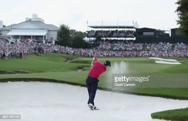 Justin Thomas of the United States plays his second shot on teh par 4 18th hole during the final round of the 2017 PGA Championship at Quail Hollow...