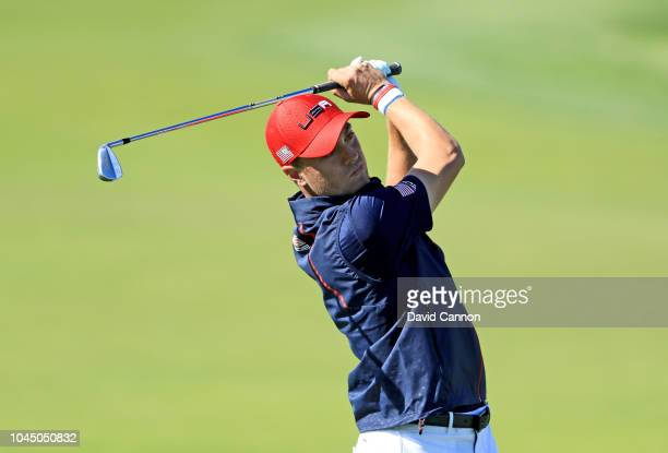 Justin Thomas of the United States plays his second shot on the 10th hole in his match against Rory McIlroy of the European Team during singles...