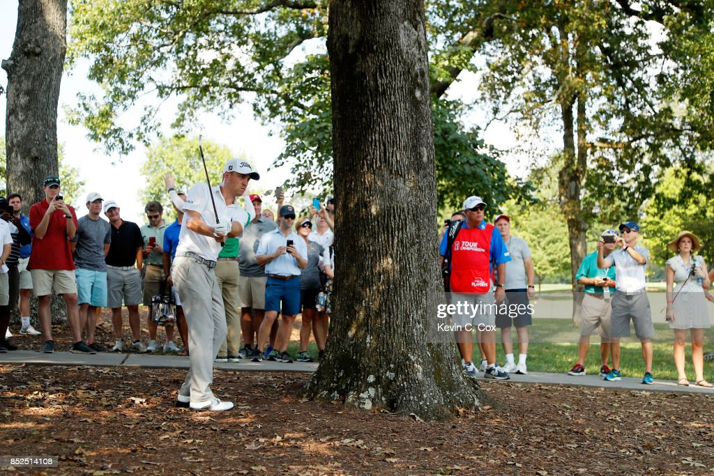 Justin Thomas of the United States plays his second shot on the sixth hole during the third round of the TOUR Championship at East Lake Golf Club on September 23, 2017 in Atlanta, Georgia.