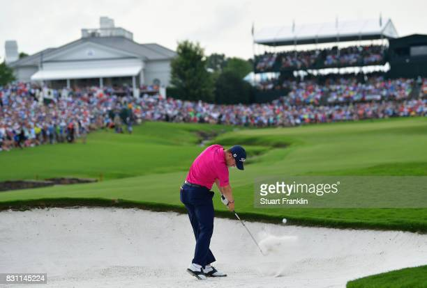 Justin Thomas of the United States plays his shot from a bunker on the 18th hole during the final round of the 2017 PGA Championship at Quail Hollow...