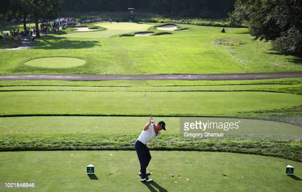 Justin Thomas of the United States plays his shot from the 11th tee during the first round of The Northern Trust on August 23 2018 at the Ridgewood...