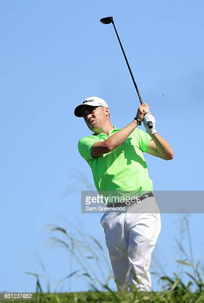 Justin Thomas of the United States plays his shot from the 12th tee during the final round of the SBS Tournament of Champions at the Plantation...