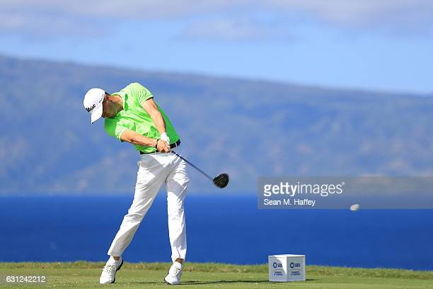 Justin Thomas of the United States plays his shot from the 13th tee during the final round of the SBS Tournament of Champions at the Plantation...