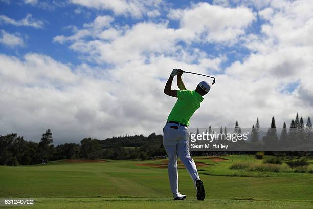 Justin Thomas of the United States plays his shot from the 14th tee during the final round of the SBS Tournament of Champions at the Plantation...