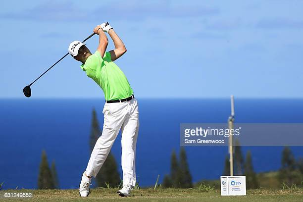 Justin Thomas of the United States plays his shot from the 16th tee during the final round of the SBS Tournament of Champions at the Plantation...