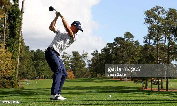 Justin Thomas of the United States plays his shot from the 17th tee during a practice round prior to the Masters at Augusta National Golf Club on...
