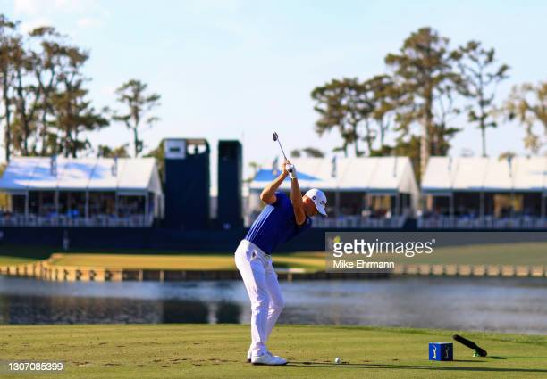 Justin Thomas of the United States plays his shot from the 17th tee during the final round of THE PLAYERS Championship on THE PLAYERS Stadium Course...