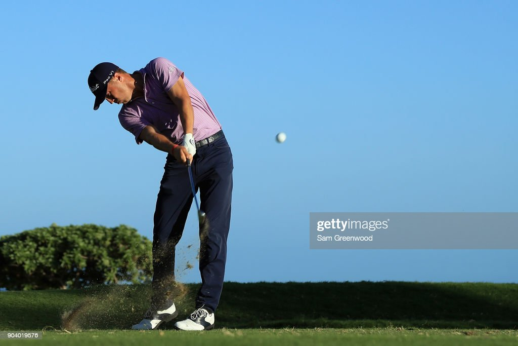 Justin Thomas of the United States plays his shot from the 17th tee during round one of the Sony Open In Hawaii at Waialae Country Club on January 11, 2018 in Honolulu, Hawaii.