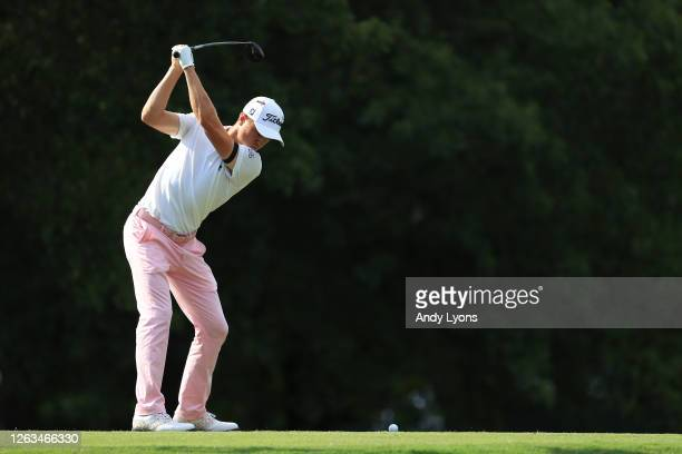 Justin Thomas of the United States plays his shot from the 18th tee during the final round of the World Golf Championship-FedEx St Jude Invitational...