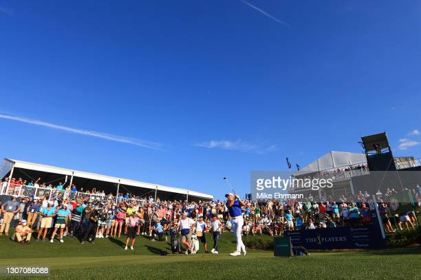 Justin Thomas of the United States plays his shot from the 18th tee during the final round of THE PLAYERS Championship on THE PLAYERS Stadium Course...